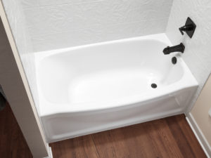 Close up of white contour bathtub hero shot w white 12x12 sim tile walls ORB fixtures