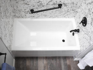 Close up of White Linear Soaker Bathtub Matte Black fixtures Hero shot
